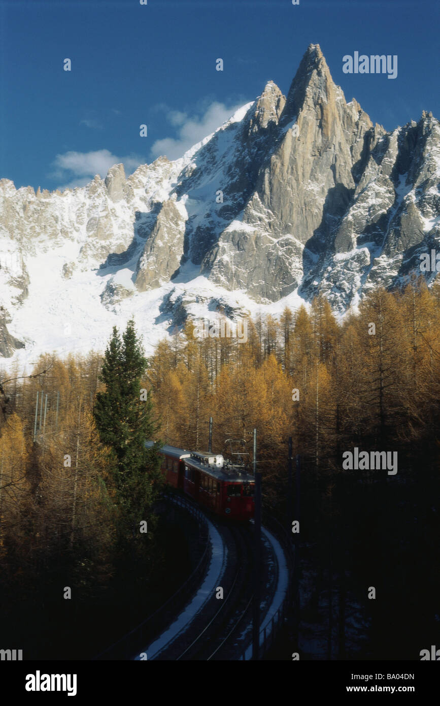 Train moving through the alps - Stock Image
