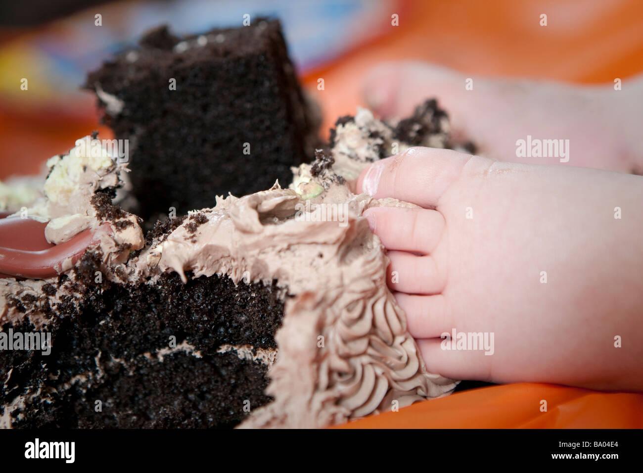 Baby Feet In A Birthday Cake Stock Photo 23360460 Alamy