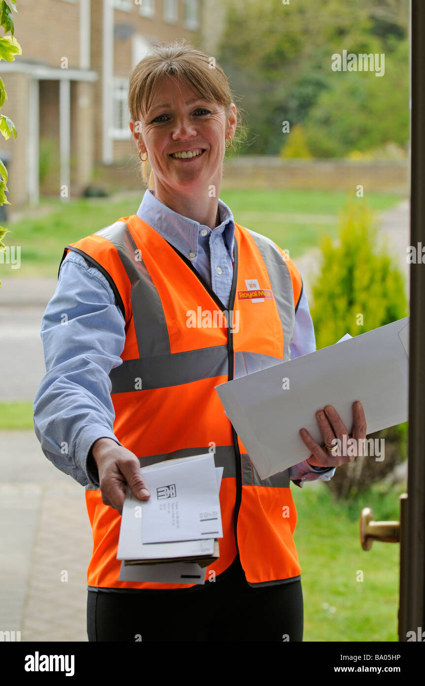 royal mail post woman delivering mail to a customer - Stock Image