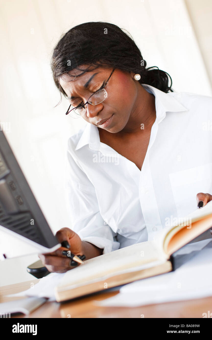 Ethnic woman at computer - Stock Image