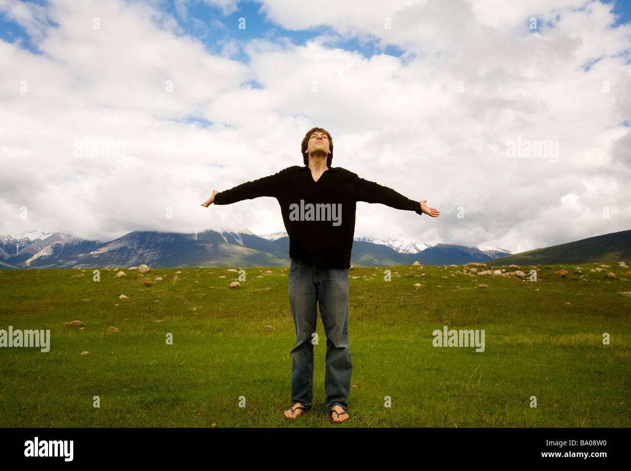 Man with open arms, Jasper, Canada - Stock Image