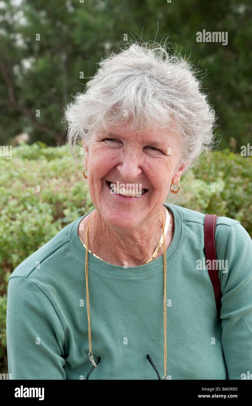 Portrait of happy senior woman smiling - Stock Image
