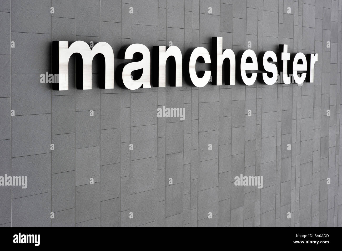 manchester sign grey wall - Stock Image