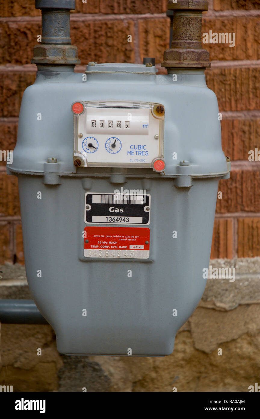 Natural gas meter outside a house - Stock Image