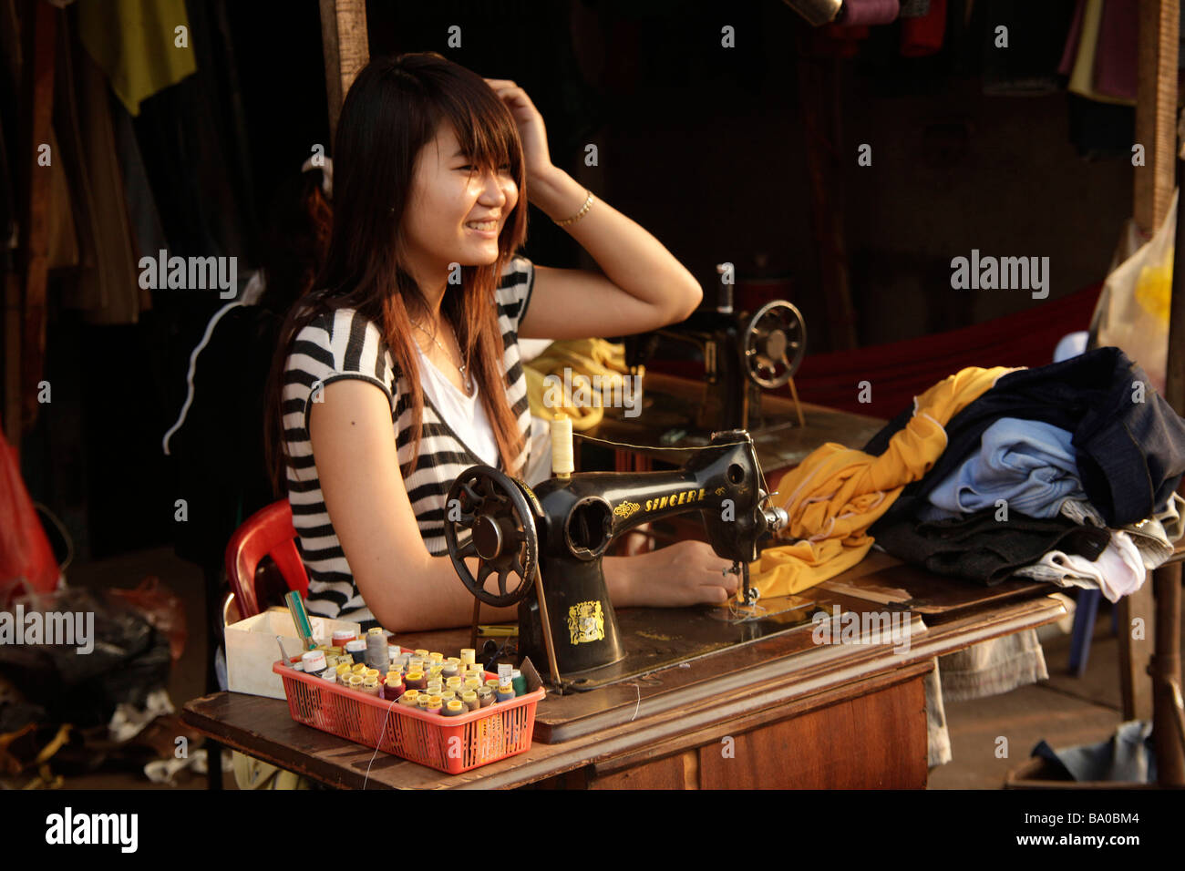 woman sewing on the market in Duong Dong on Phu Quoc island Vietnam Stock Photo