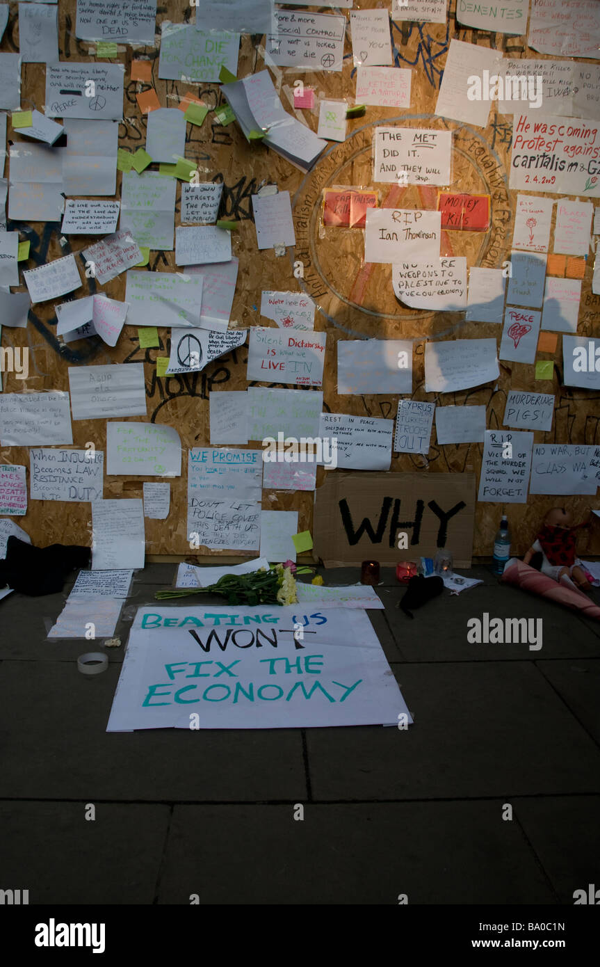 Notes posted on notice board, by protesters of the G20, at Bank in London. - Stock Image
