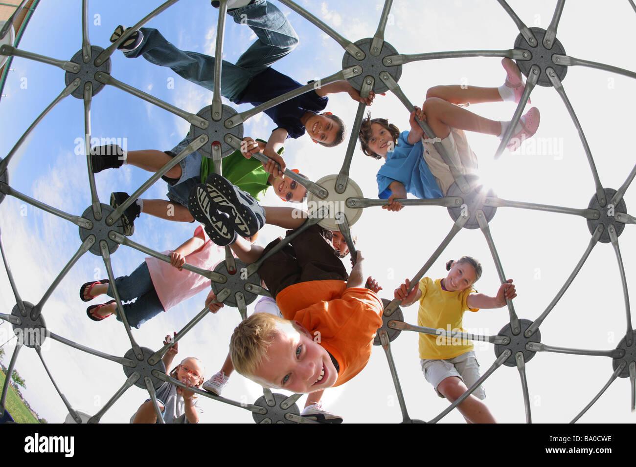 School children on playground structure - Stock Image