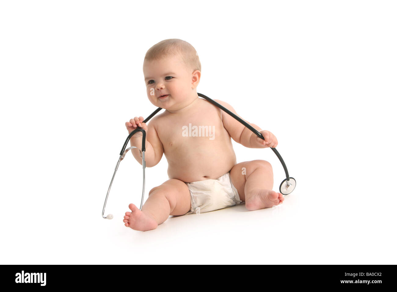Baby with stethoscope on white background - Stock Image