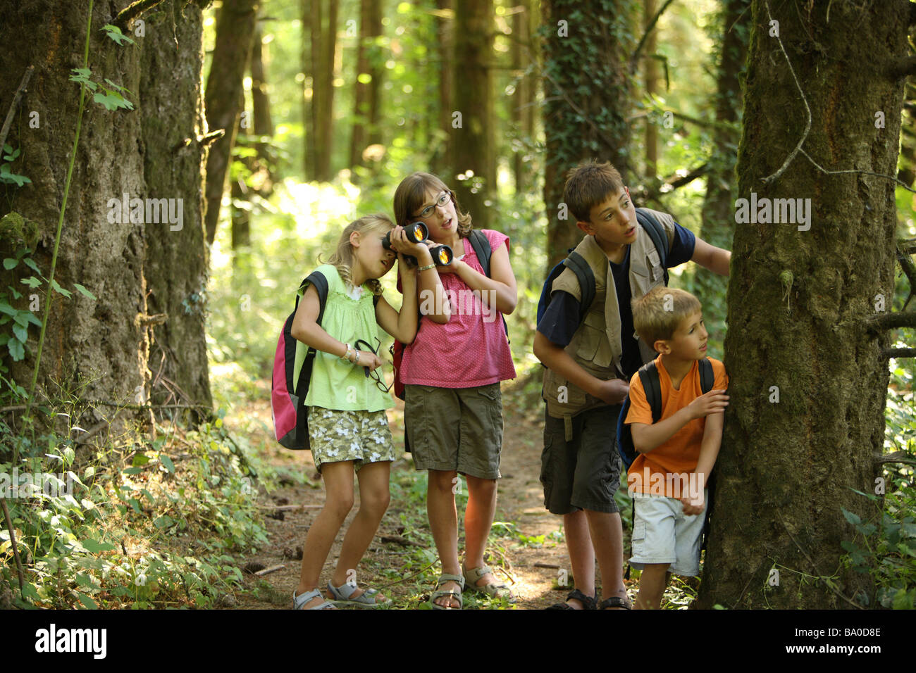 group of kids with camping gear in woods people the74 camping