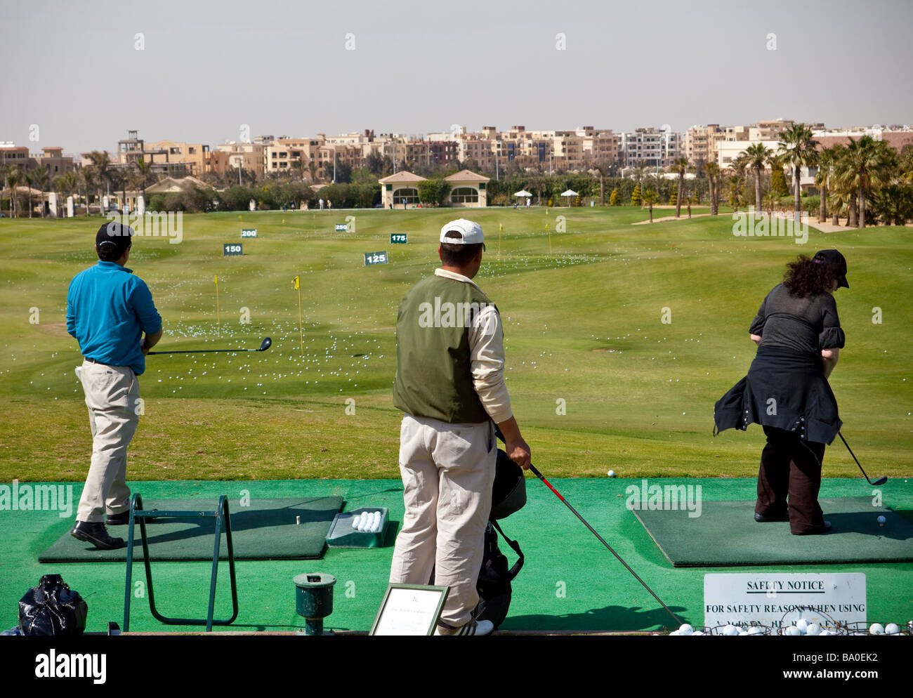 golfers on driving range, Katameya Heights golf course, New Cairo, Egypt - Stock Image