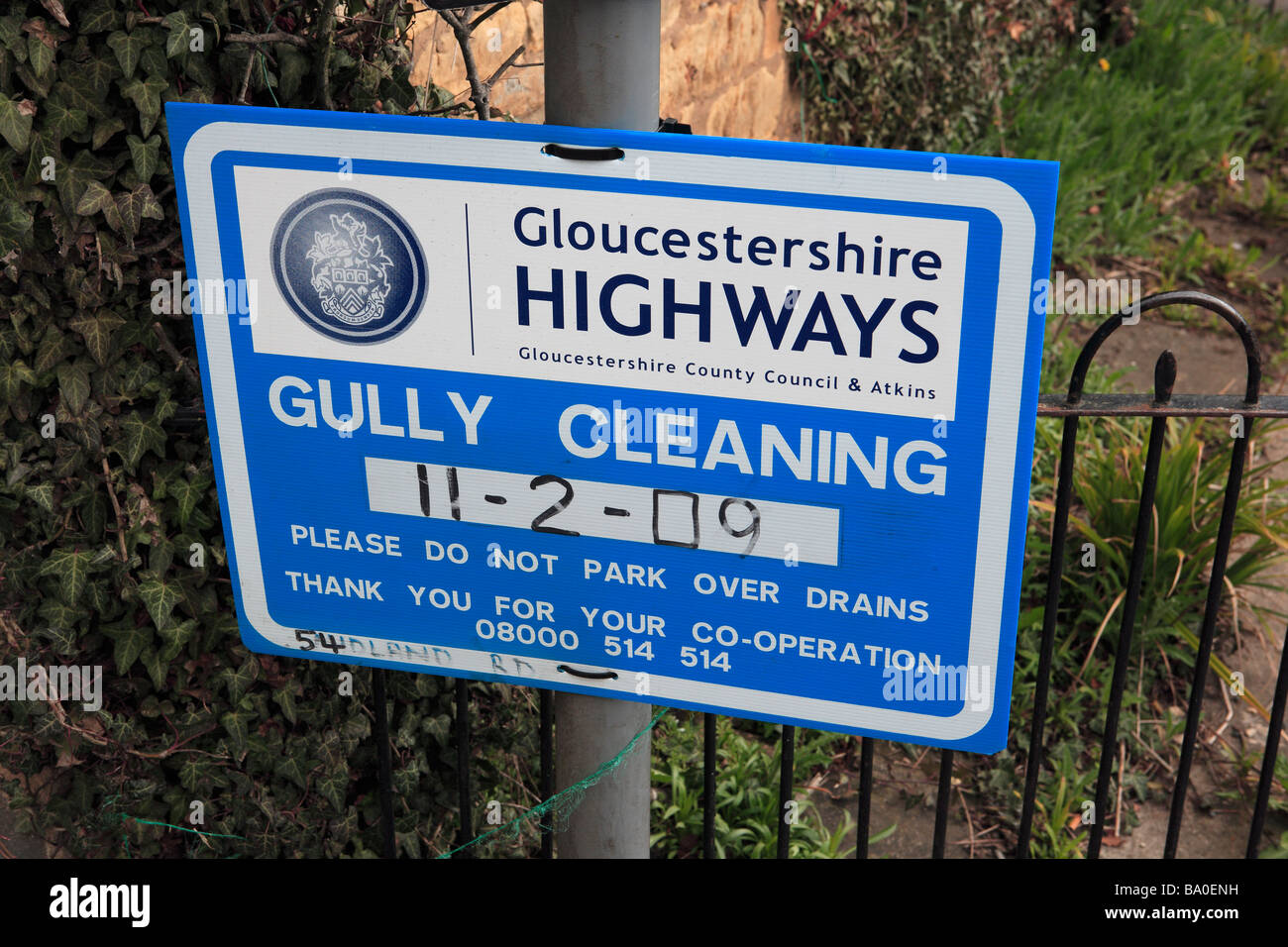 Cotswolds Gully Cleaning Sign - Stock Image