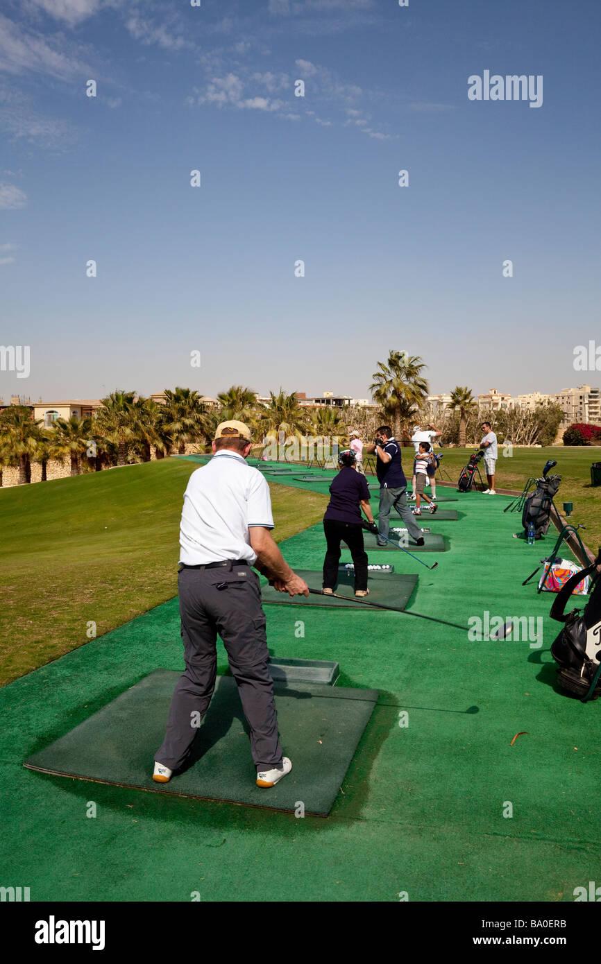 golfers on driving range, Katameya Heights golf course, New Cairo, Egypt - Stock Image