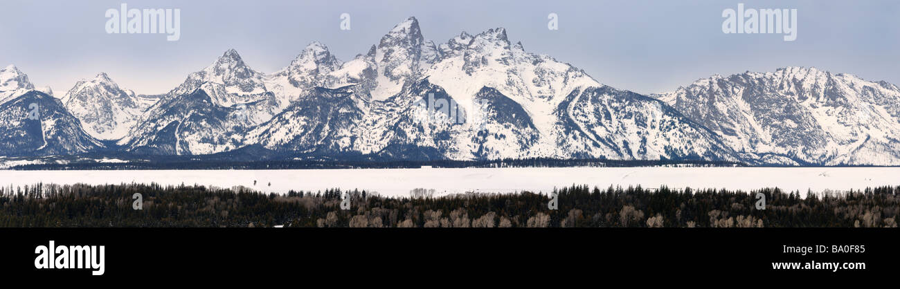 Panorama of the Grand Teton peaks in winter from Teton Point turnout Jackson Hole Wyoming - Stock Image