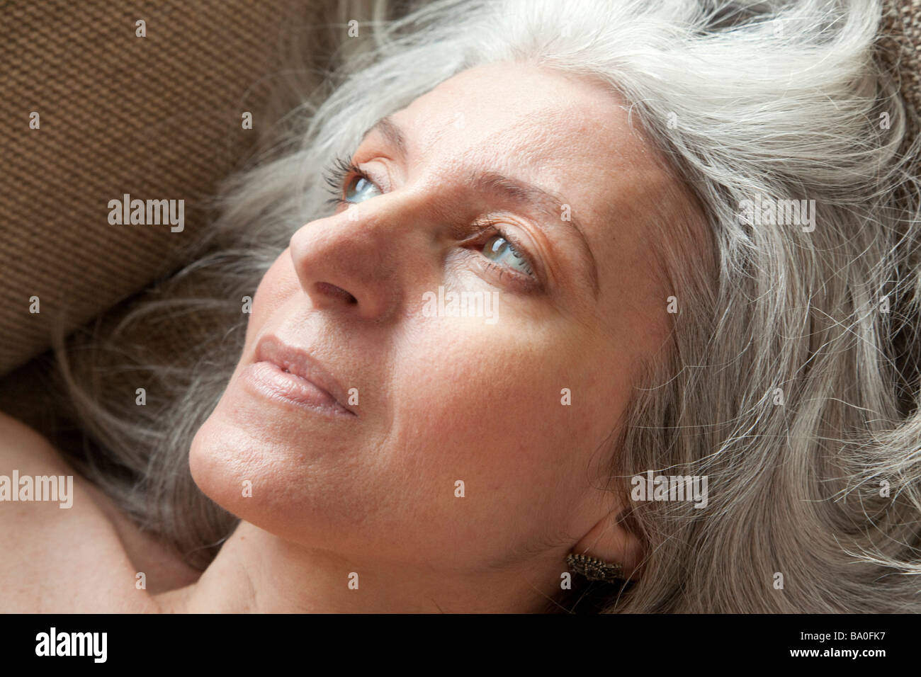 senior woman looking pensive / daydreaming Stock Photo