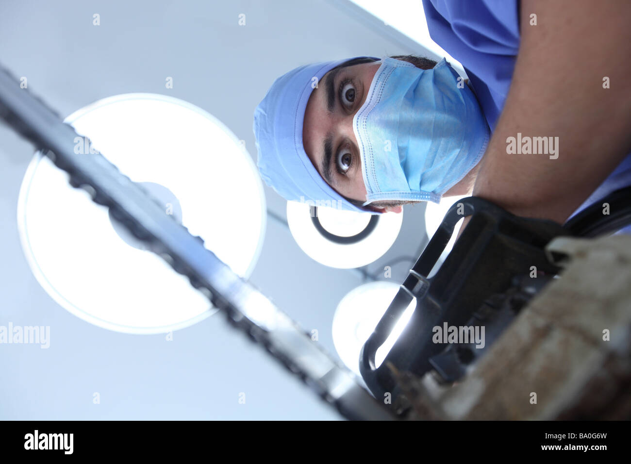 Crazy surgeon with chainsaw - Stock Image