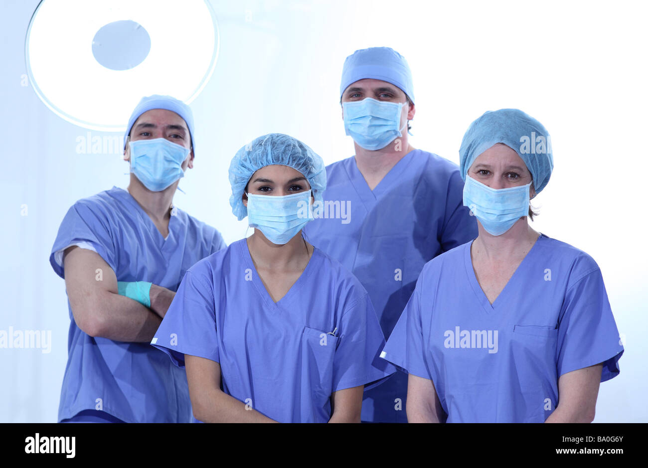 Group of surgeons in scrubs - Stock Image