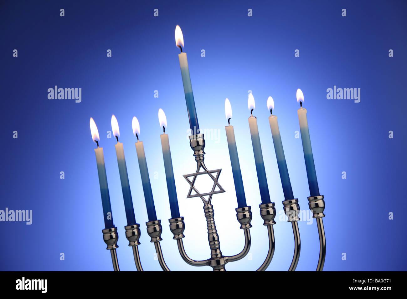 Jewish Hanukkah Menorah with blue background - Stock Image