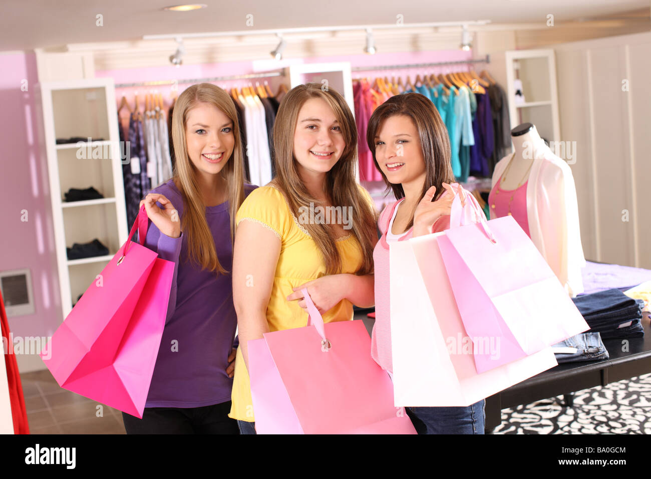 Portrait of three teen shoppers - Stock Image