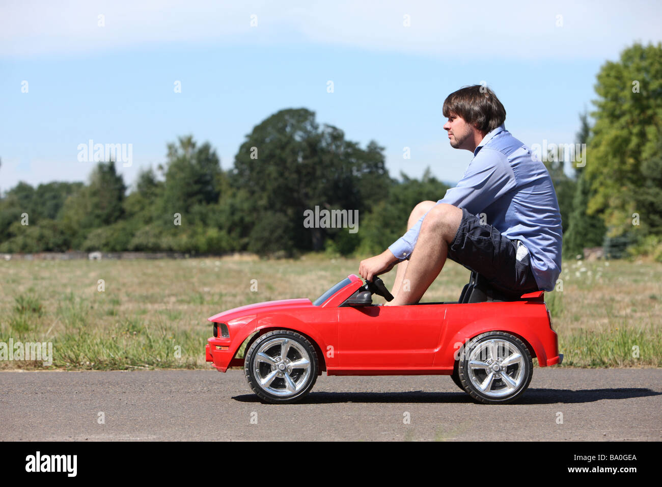 Man Driving A Small Car Stock Photo 23369874 Alamy