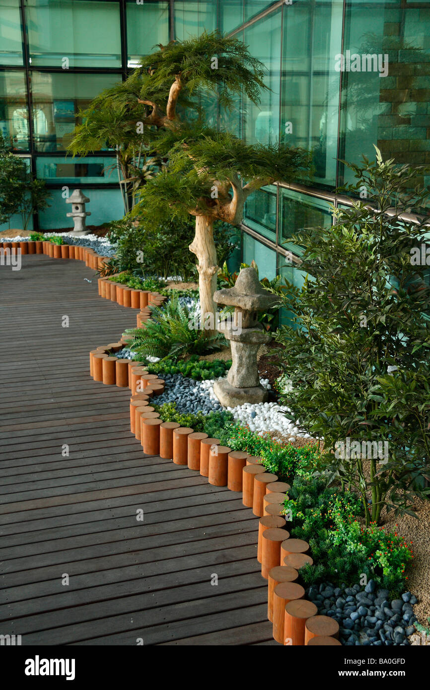 An Outdoor Korean Garden With Live Miniature Trees At The Open Terrace Of Fish Market Building In Busan Korea