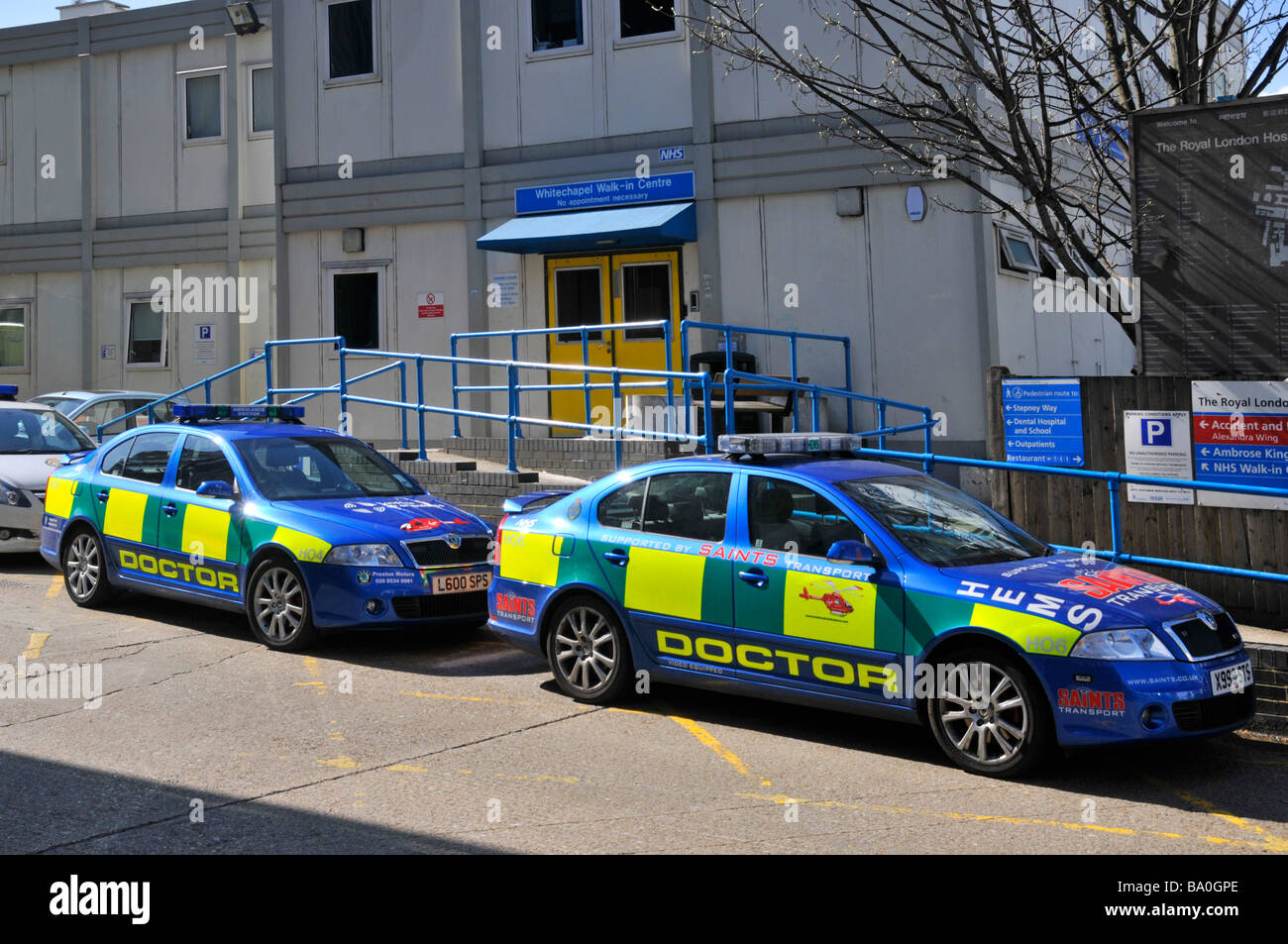 Sponsored Doctors cars parked outside Whitechapel NHS walk in centre within the grounds of the Royal London Hospital - Stock Image
