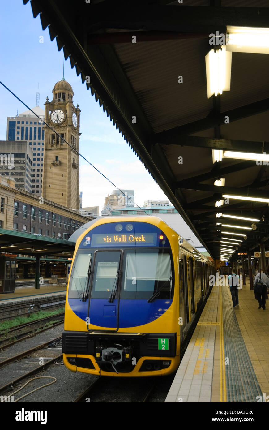 Electric passenger / commuter train stopped by the platforms at Central Station terminus, Sydney, Australia. Commuter Stock Photo