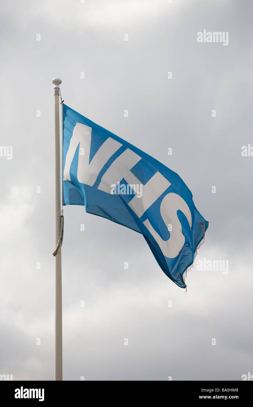 Flag of the National Health Service (NHS) flying outside a UK hospital Stock Photo