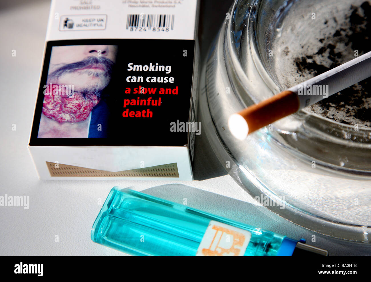 Graphic health warning on UK cigarette packet - Stock Image