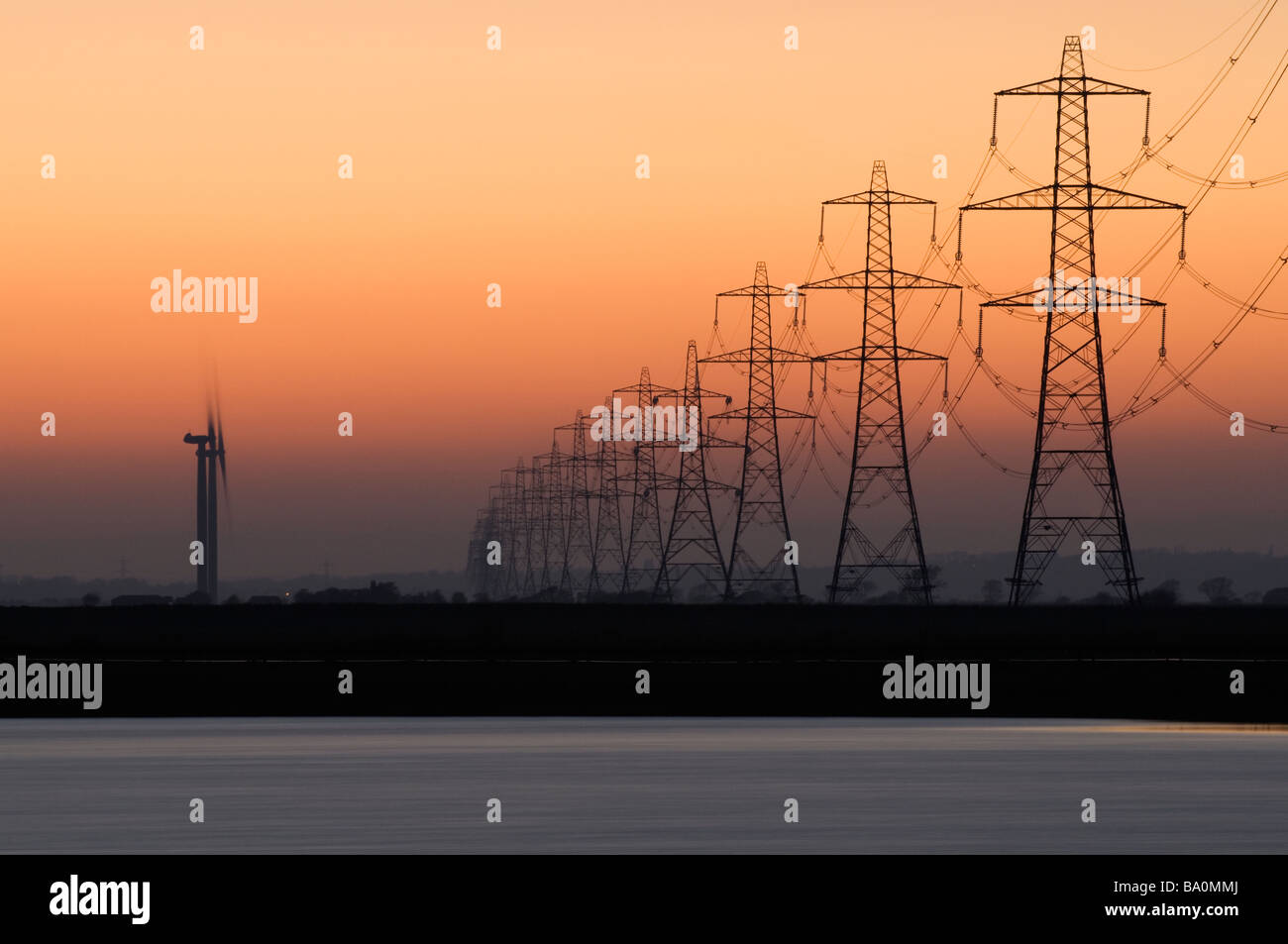 Wind turbines and power pylons and lines Romney Marsh Kent UK - Stock Image