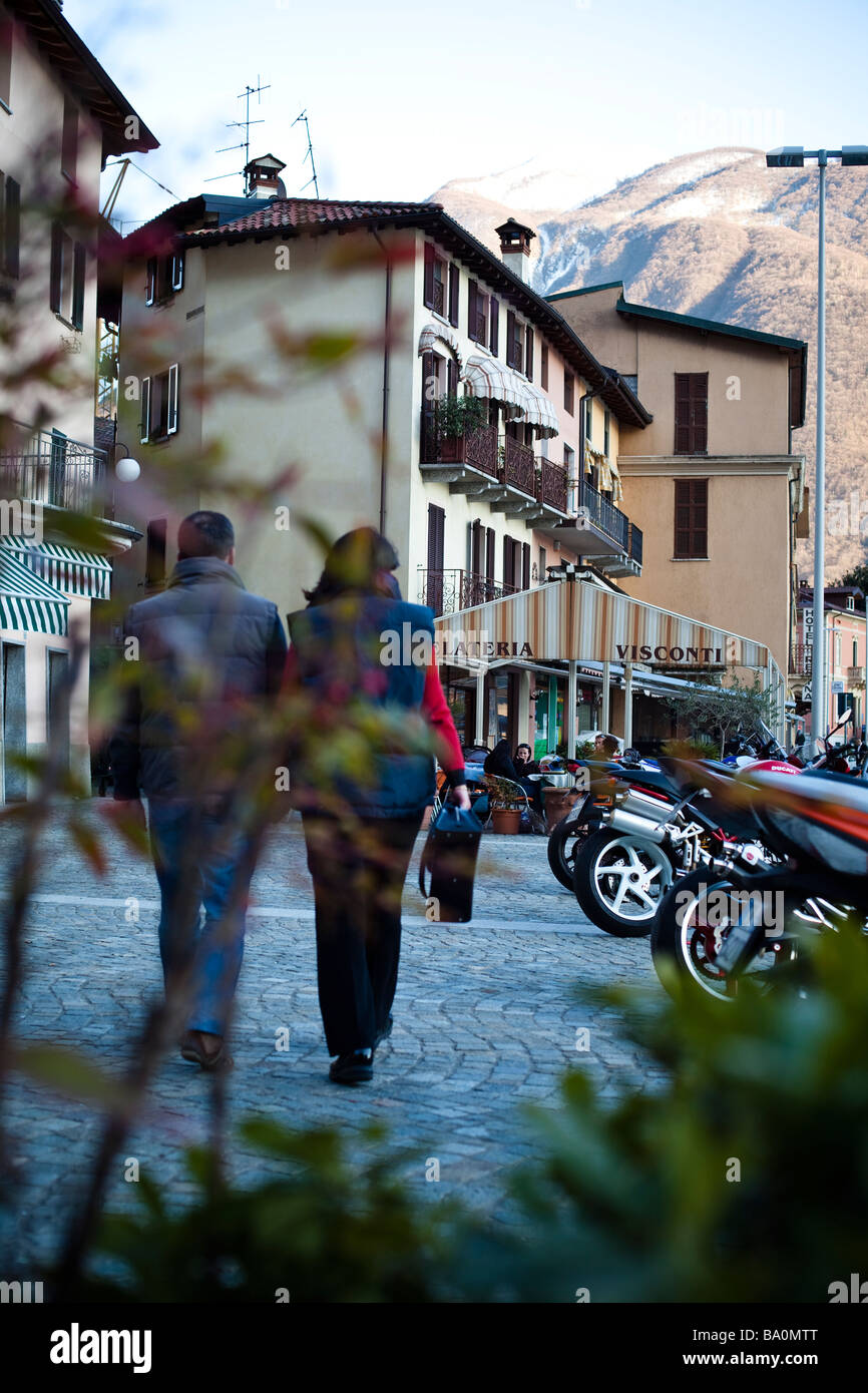 Elderly Couple in love going for a walk in the town in Porlezza, Italy - Stock Image