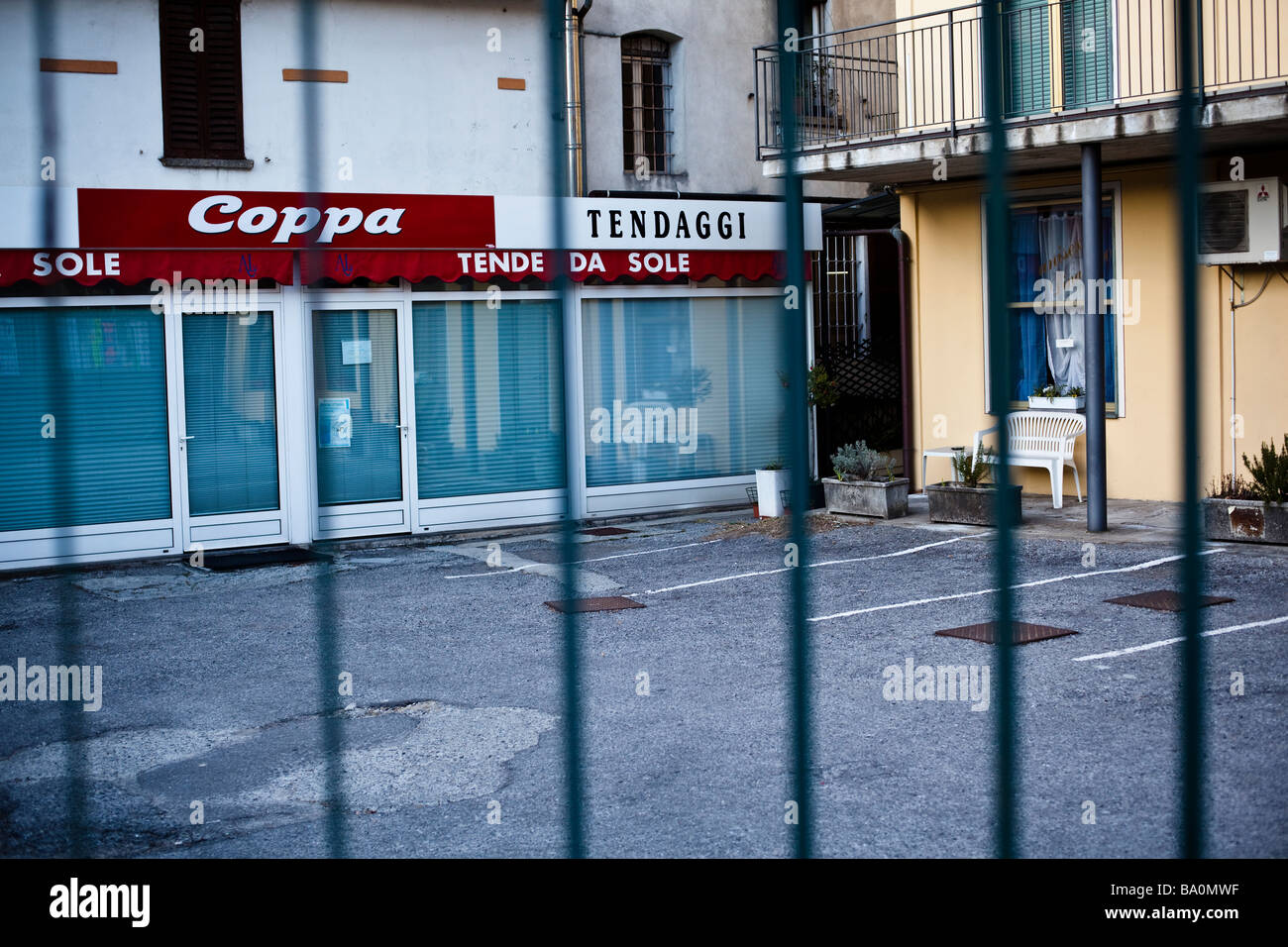 Grid in front a closed Coppa Branch in Porlezza, Italy - Stock Image