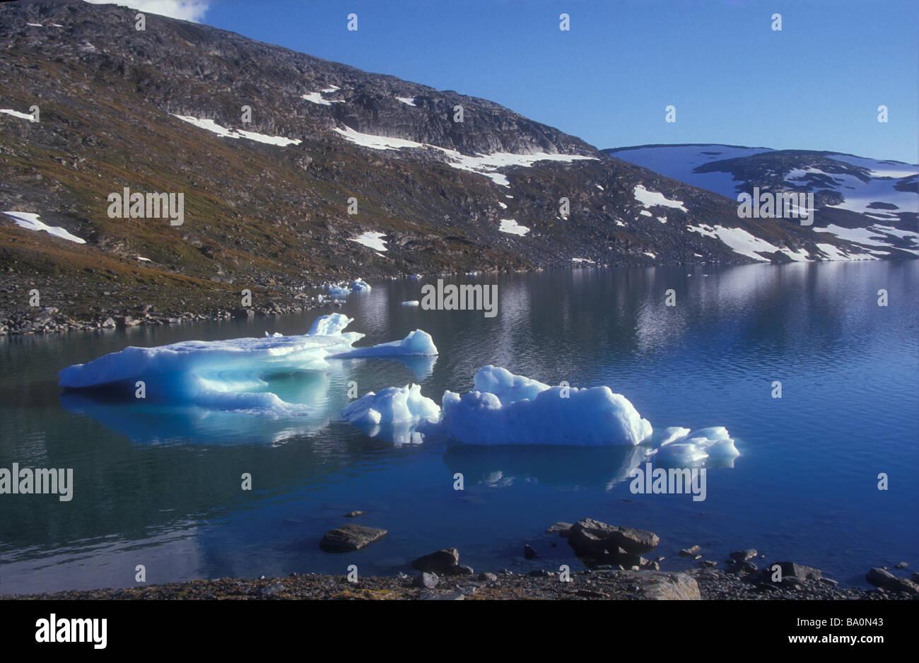 Melting ice floe in blue Mountain lake Lapland Sweden - Stock Image