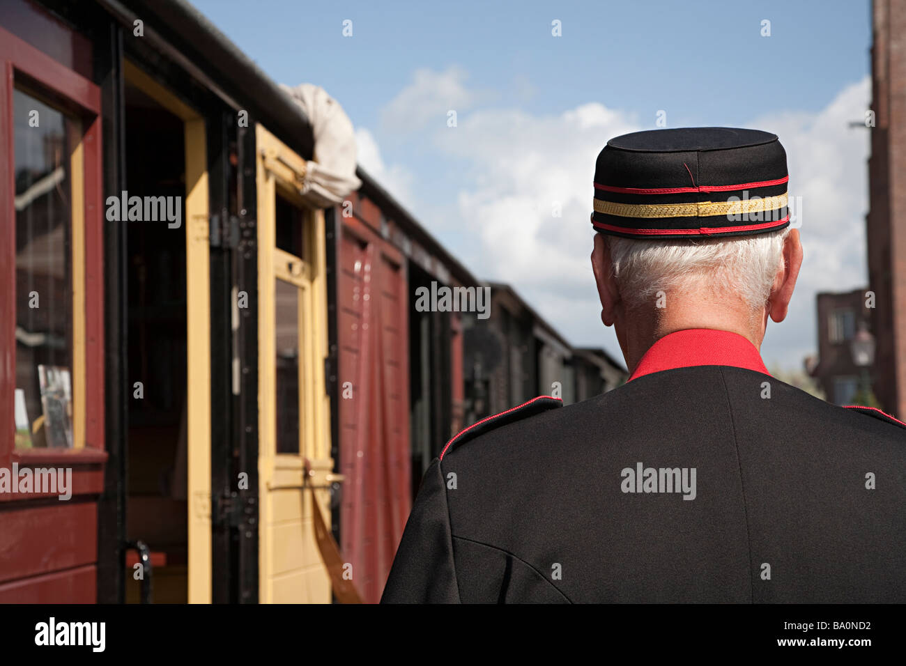 Conductor at station for recreation steam train Medemblik Netherlands Stock Photo