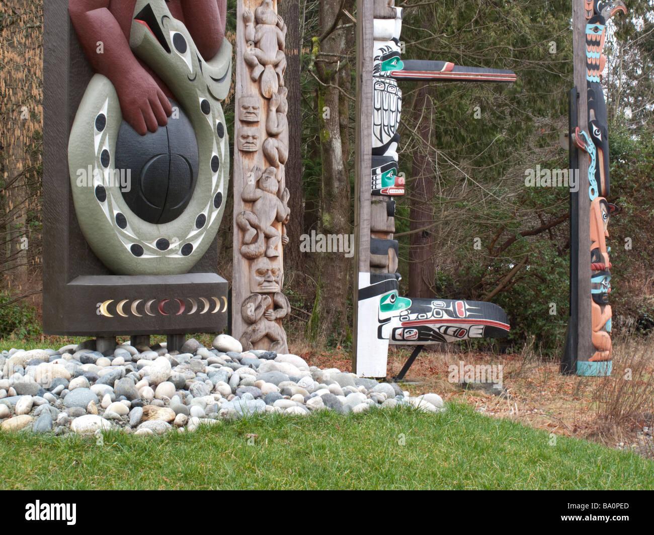Totem poles at Totem Park in Stanley Park Vancouver - Stock Image