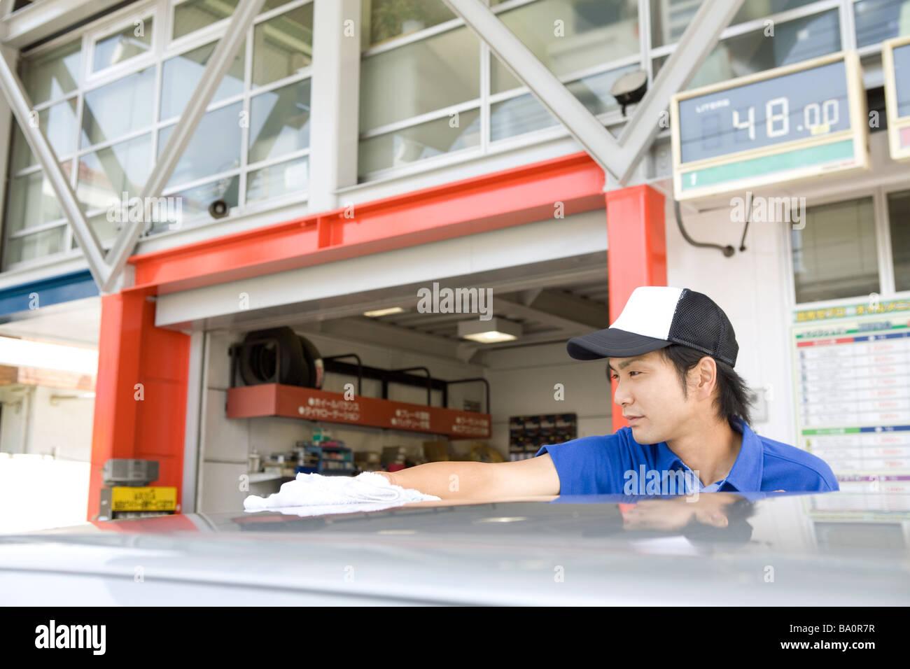 gas station clerk washing car