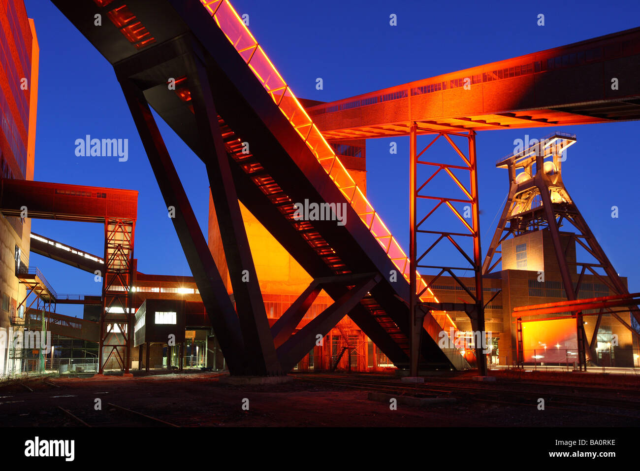 Unesco World heritage site former coal mine Zeche Zollverein. Exhibition halls in the Kohlewaesche. Red lighted - Stock Image