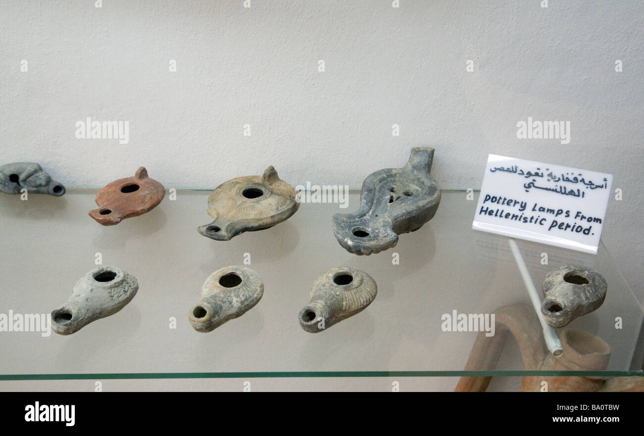 Hellenistic age pottery oil lamps, in the Museum of Archaeology, Jerash, Jordan - Stock Image