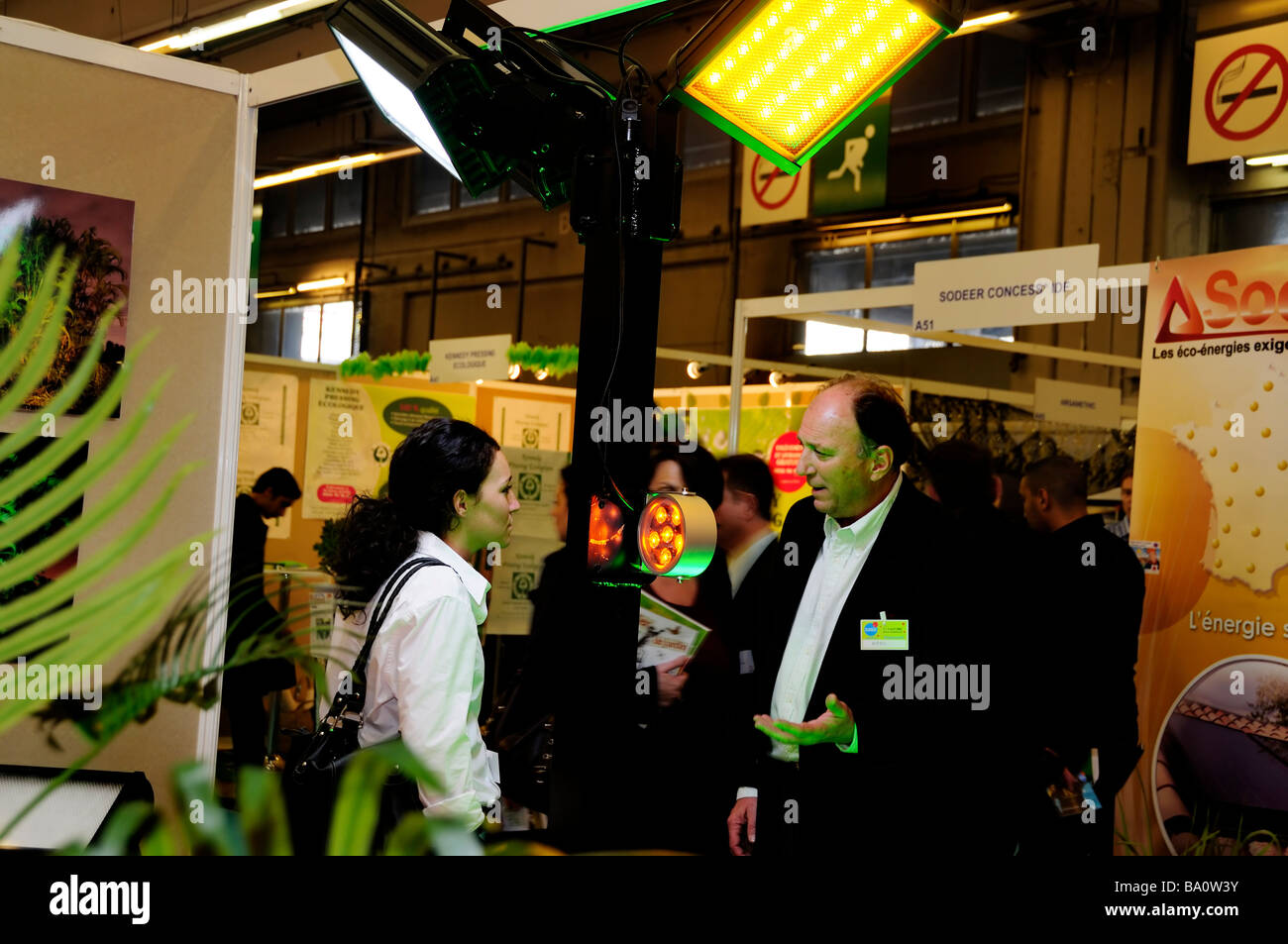PARIS, FRANCE, Businessman Speaking  Sustainability Trade Show,  LED Lighting Exhibit 'Abyss Industry Co' - Stock Image