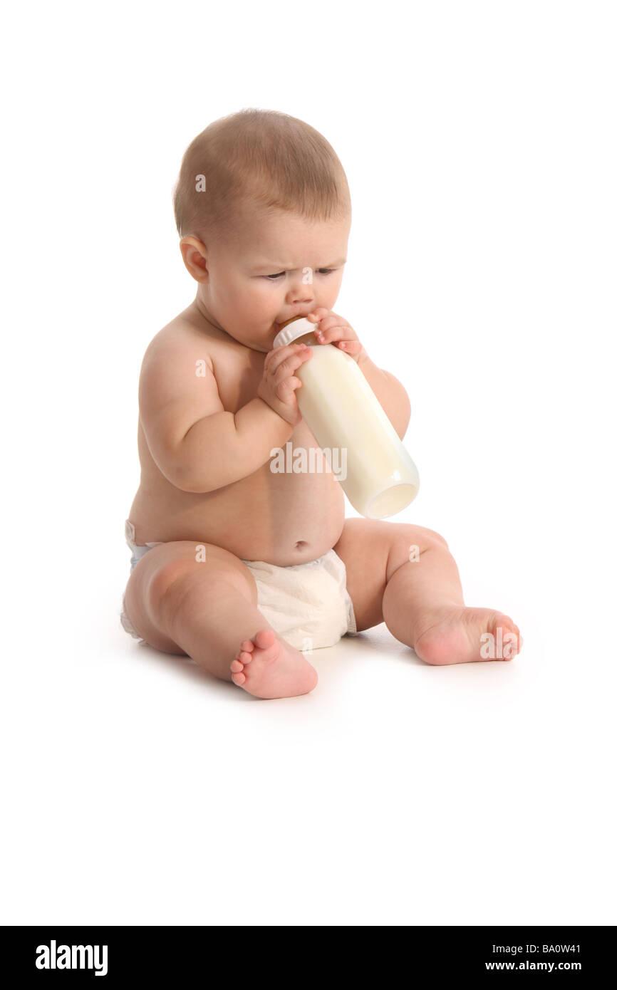 Baby with bottle on white background - Stock Image