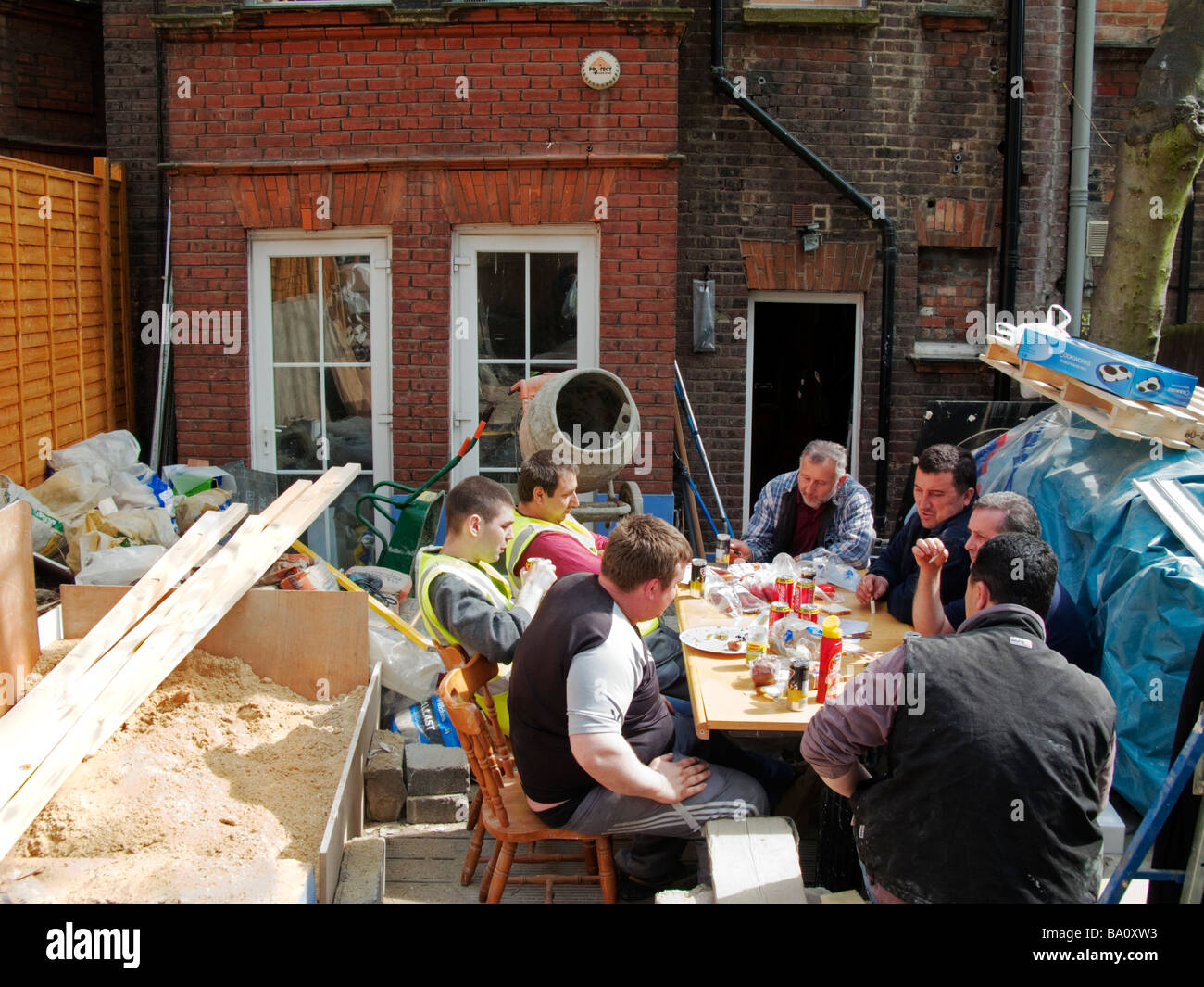 East European builders take a lunch break on building site London England - Stock Image