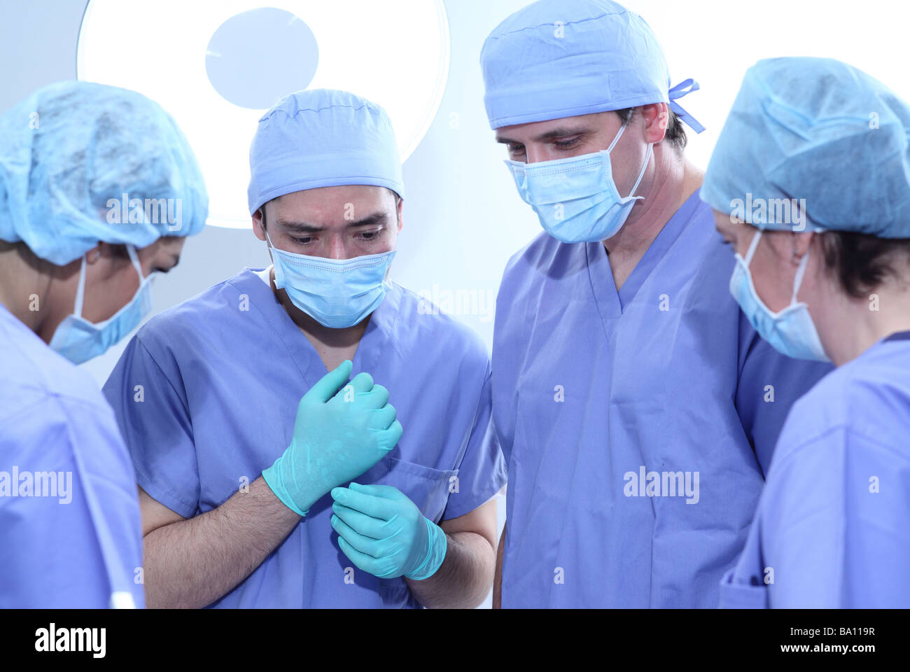 Group of surgeons in operating room - Stock Image