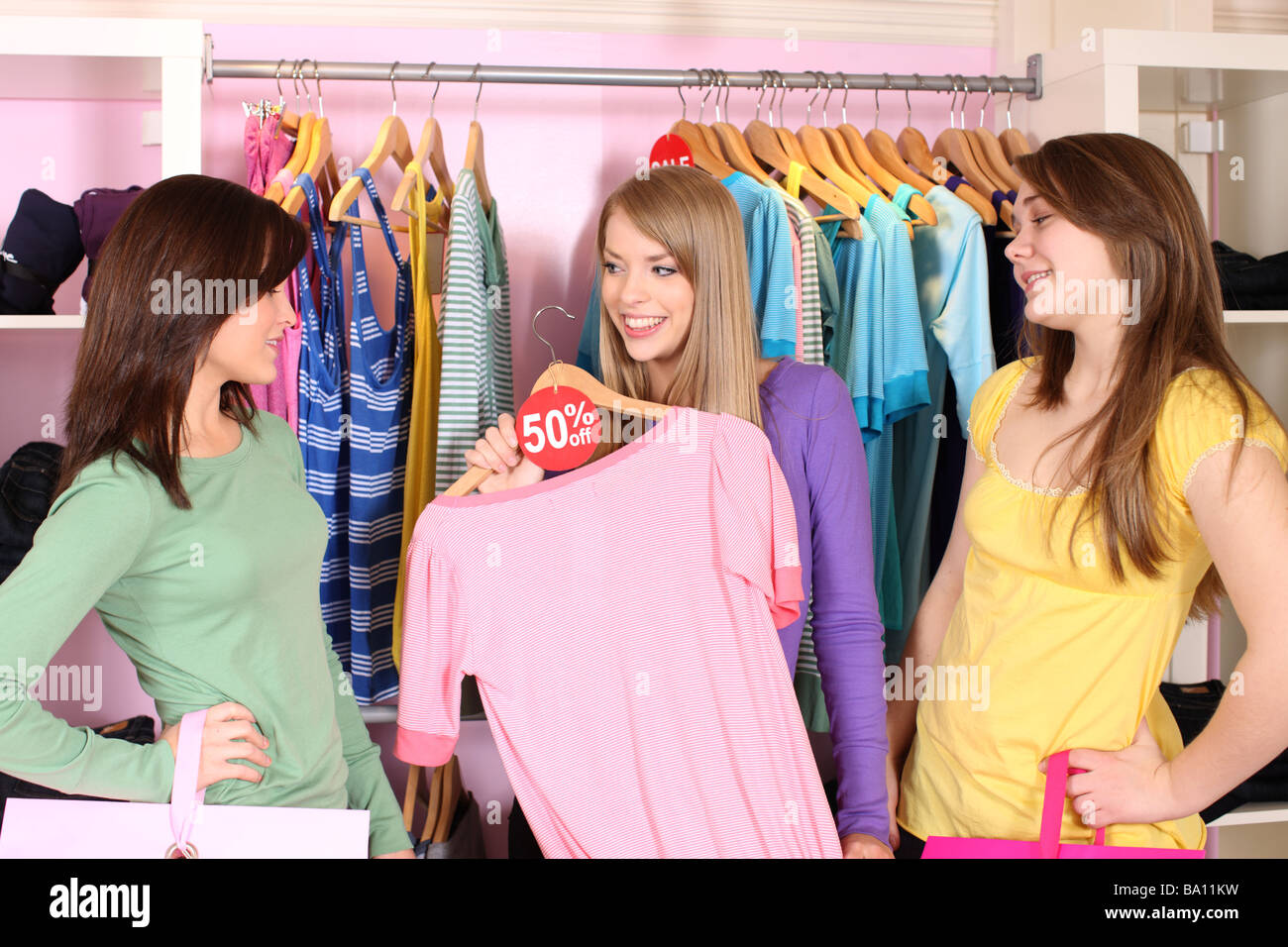 Three friends shopping together - Stock Image