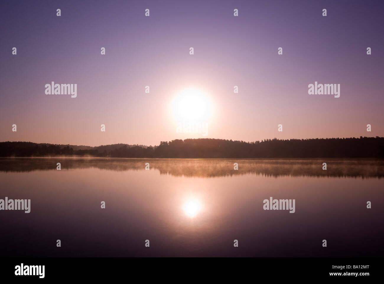 Sunrise over misty lake Mazury Poland aRGB - Stock Image