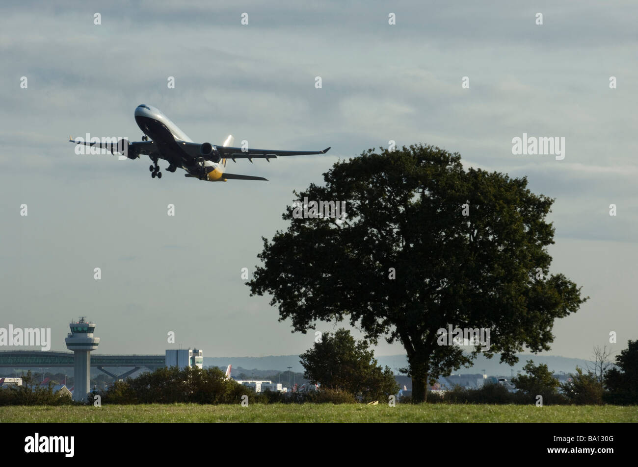 The wheels are retracting into the aircraft fuselage as a Monarch Airlines Jet airplane takes off from Gatwick Stock Photo