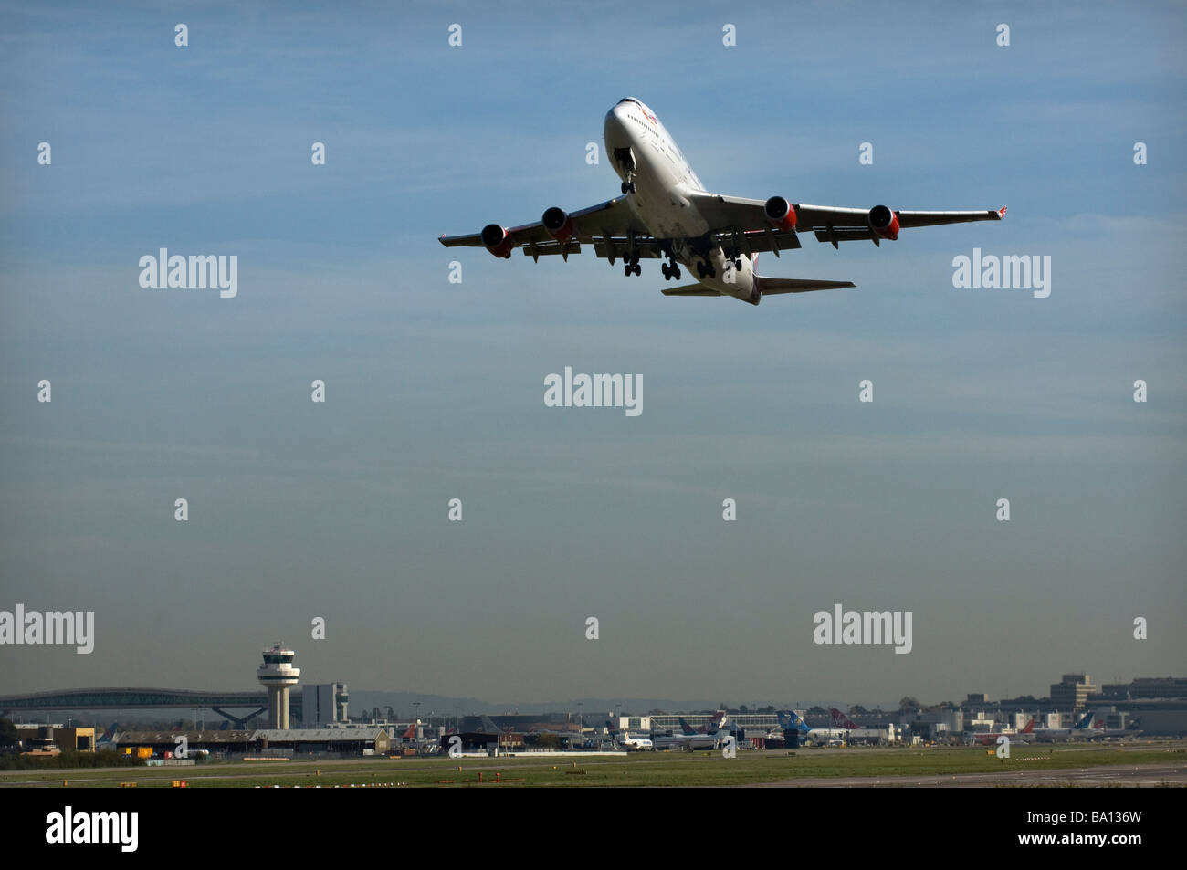 A Virgin Atlantic Boeing 747 Jumbo Jet takes off from Gatwick Airport West Sussex on a transatlantic flight - Stock Image