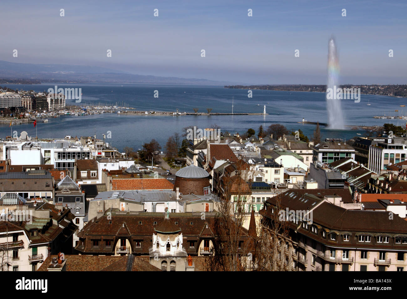 Lake Geneva (Lac Léman) and Jet d'Eau seen from St Peter's Cathedral, Geneva, Switzerland - Stock Image