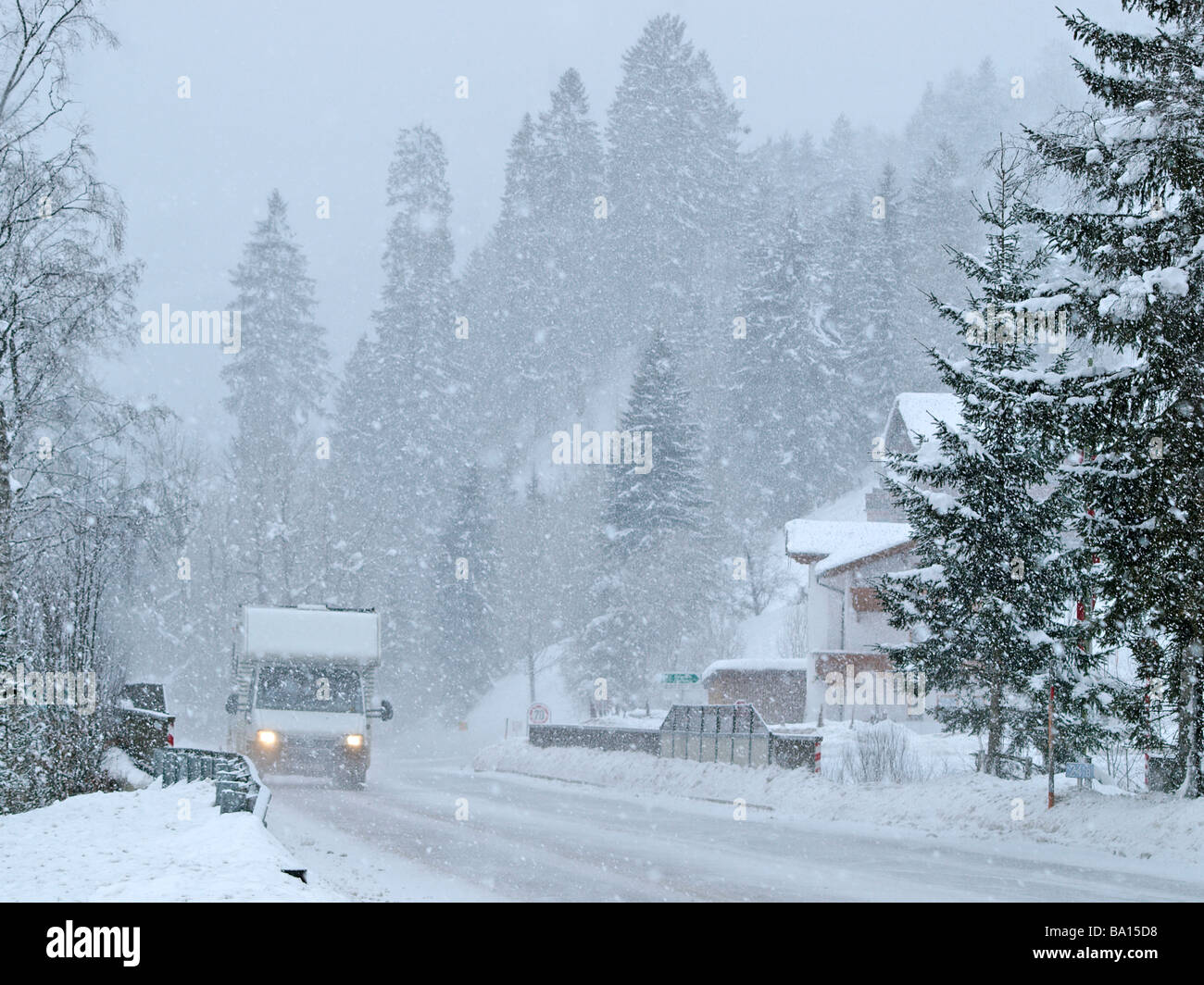 Car driving through heavy snowing, Achenkirch, Austria - Stock Image