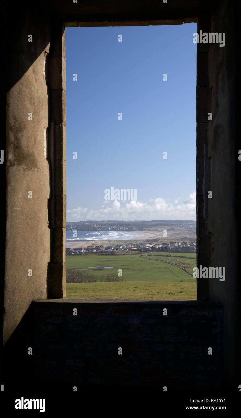 looking out of empty stone window frame in ruin of downhill demesne county londonderry derry northern ireland - Stock Image