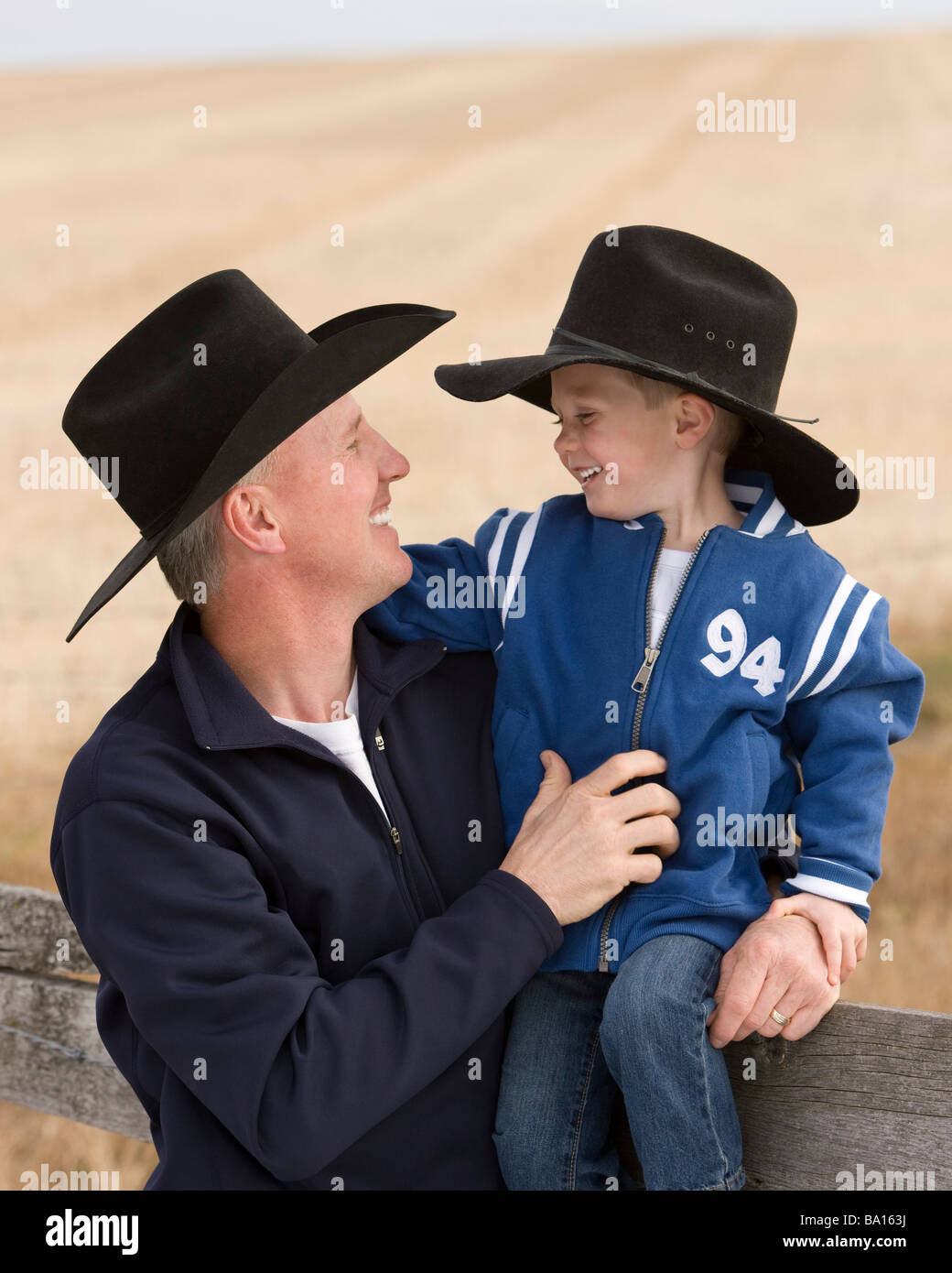 Father and son wearing cowboy hats Stock Photo  23383686 - Alamy 5a68551829b