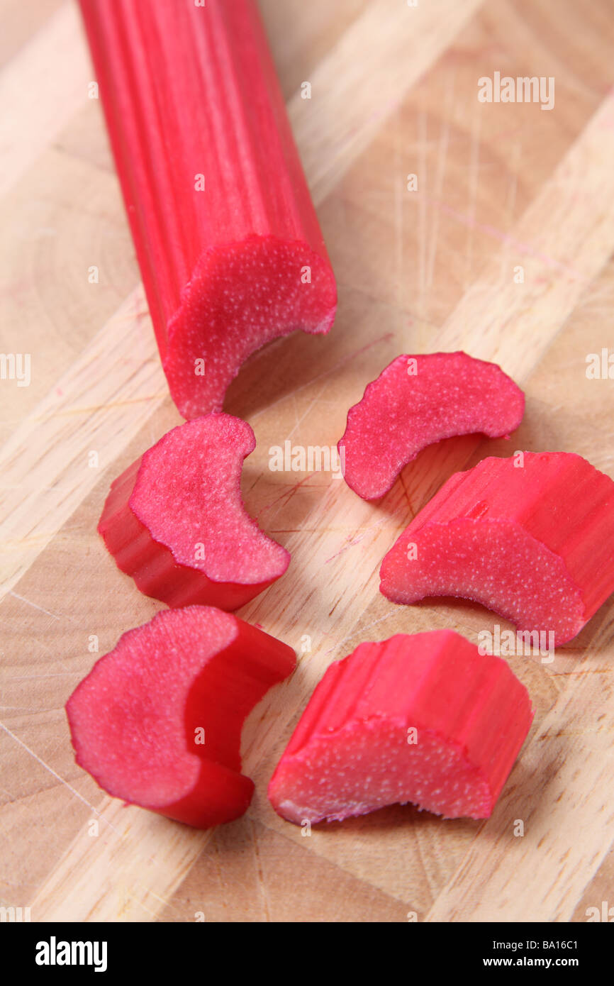 Chopped rhubarb on cutting board - Stock Image